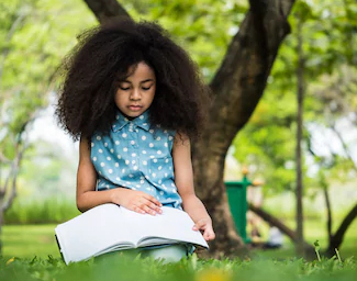 beautiful-girl-reading-book-while-260nw-1062537935 (1)